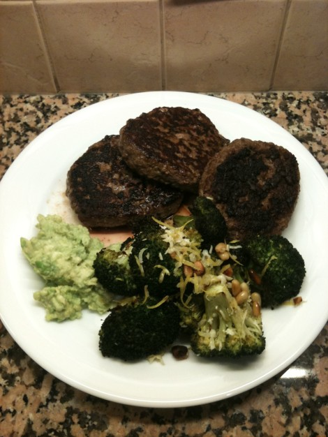 Beef and lamb burgers with mock-guac and broccoli.