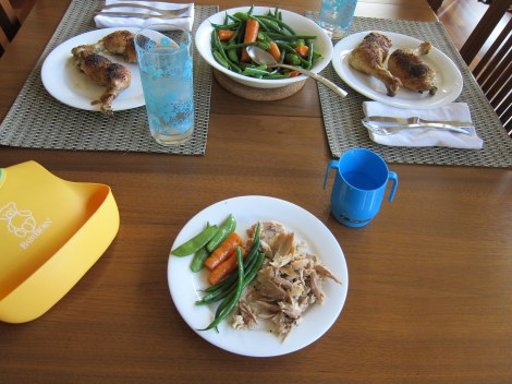 A typical family dinner: Roasted chicken legs and steamed vegetables topped with grass-fed butter.