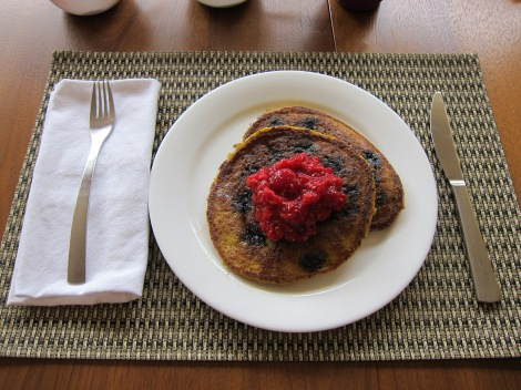 Paleo pancakes with blueberries, topped with raspberry compôte.