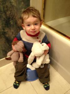 We knew it was time to revisit potty use when we found him in his bathroom, fully clothed, sitting on his potty.