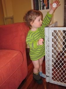Oliver's finest potty training attire: top, socks, no pants, and one boot, on the wrong foot.