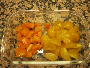 Orange pepper pieces and yellow tomatoes.