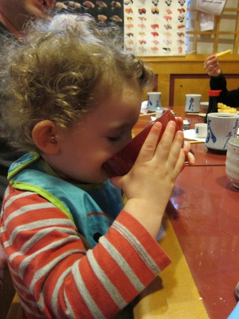Oliver enjoys a cup of miso soup at our favourite local sushi joint. The tiny restaurant, which is a popular destination among celebrities and NHL hockey players, seats fewer than 40 people and has two high chairs plus a booster seat!