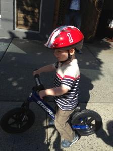 Shiny blue bike and a shiny red helmet.
