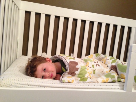 "Oliver in his ""big boy"" bed."