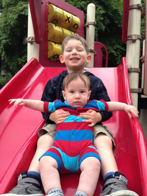 Big brother Oliver introducing Alexander to the joys of the playground.